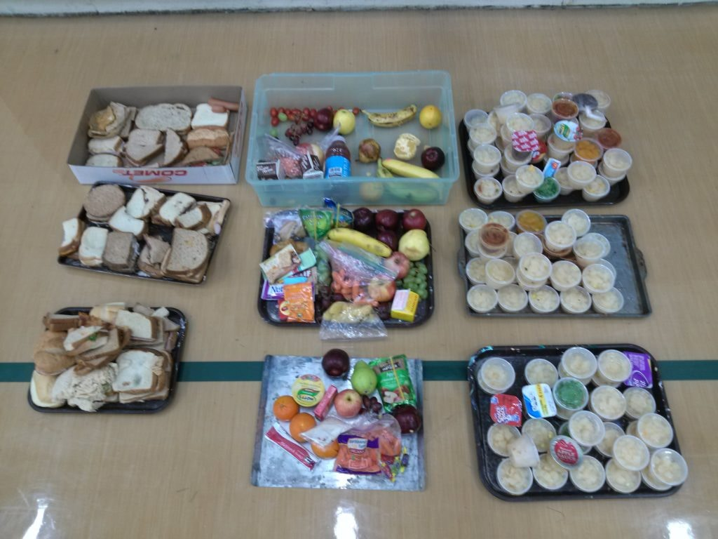 Trays full of uneaten food found at another school waste audit lead by SCARCE.