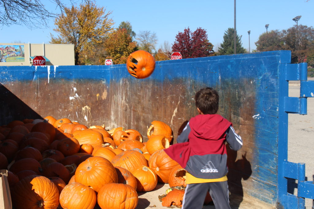 A young resident in Addison pitches his pumpkin.
